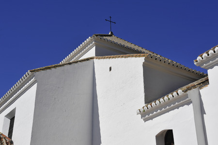 whitewashed: A whitewashed Spanish Andalucian church with pantiled roof and cross