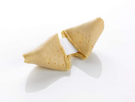 motto: A fortune cookie open with blank paper motto on a white background