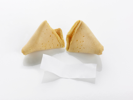 snapped: A fortune cookie open with blank paper motto on a white background