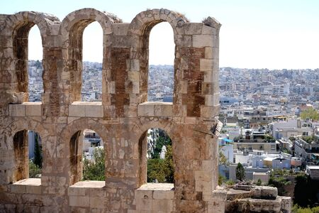 arcos de piedra: a view of ancient stone arches and the city of Athens Greece