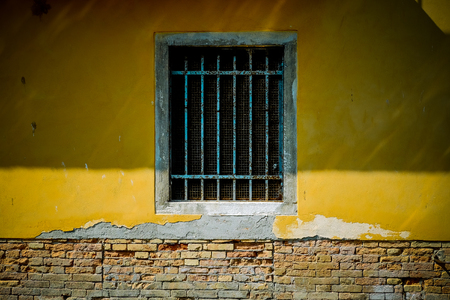 a window in Venice with metal bars on it Stock Photo