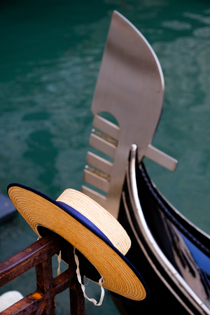 Gondoliers straw boater hat and the bow of a Gondola in Venice Italy