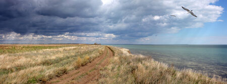 rain cloud: The road in the desert along the coast � banner, panorama Stock Photo