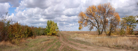Dirt road in the autumn fields - banner panorama photo