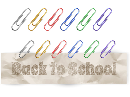 Set of colorful metallic paper clips, isolated on white
