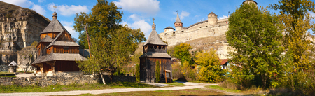 View of the old wooden church and a castle in Kamenetz Podolsky, Ukraine, Europe