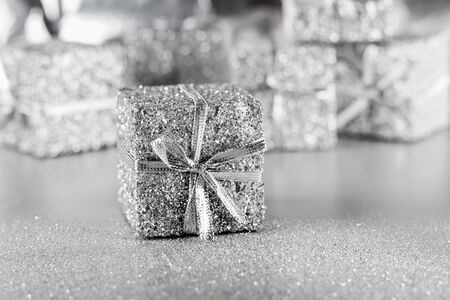silver ribbon: Silver gift with ribbon and bow on a silver background Stock Photo