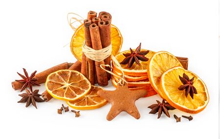 Dried oranges, star anise, cinnamon sticks and gingerbread, isolated on white background