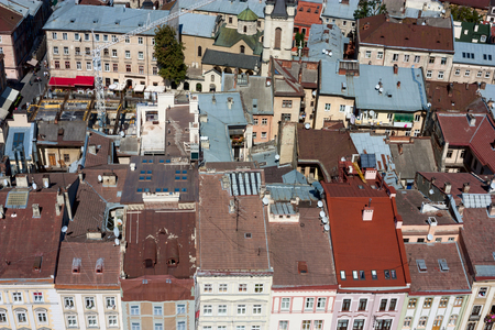 lviv: Lviv, Ukraine. Beautiful top view with roofs of old european town from the the city hall. Stock Photo