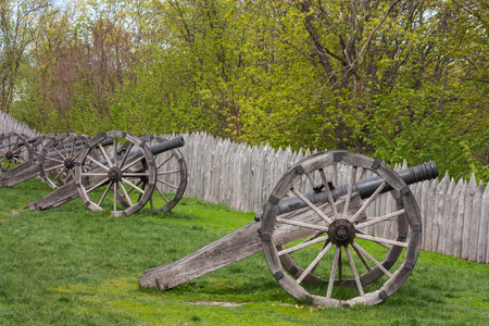 Old cannons with fortified stockade wooden defense wall. Baturyn town in Ukraine