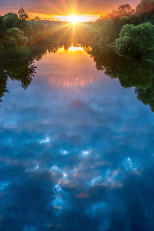 Magic summer sunset over the river called Siverskyi Donets in Ukraine