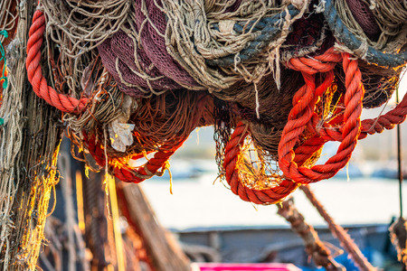 trawler net: Drying fishing nets on the trawler in city harbor at sunset of the day