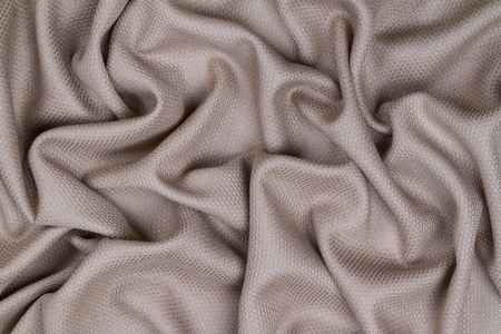 Lilac woolen crumpled wrinkled fabric with waves, background crumpled tissue  Stock Photo