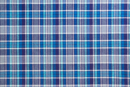 Flannel, cotton into the classic scottish cell as textile background in vintage style