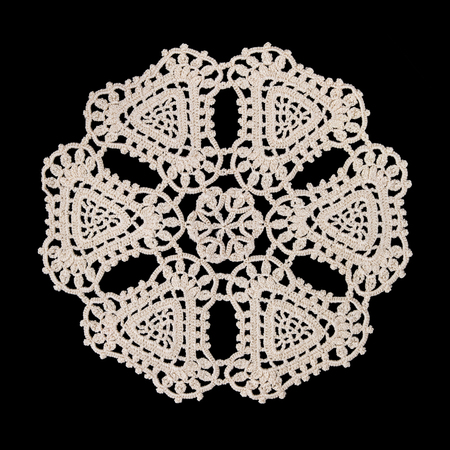Beautiful old napkin embroidery of white thread handmade on dark background in vintage style Stock Photo