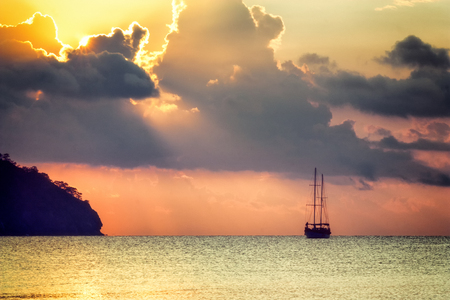 Beautiful seascape - view of the morning sea with a sailboat in the bay of Adrasan, coast of the Mediterranean Sea, Antalya Province, Turkey Stock Photo