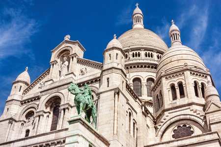 The Parisian citylandscape - view of The Basilica of the Sacred Heart of Paris on background of the sky with clouds, Paris, France Stock fotó