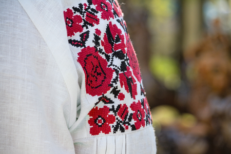 Beautiful Ukrainian embroidery on authentic women folk clothes, close-up