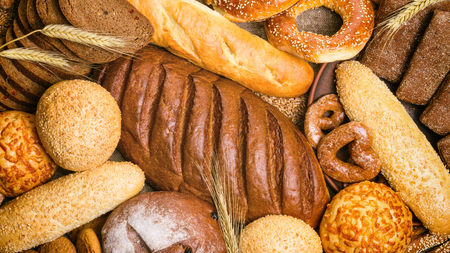 Fresh bread and bakery in the form of background, top view, close-up