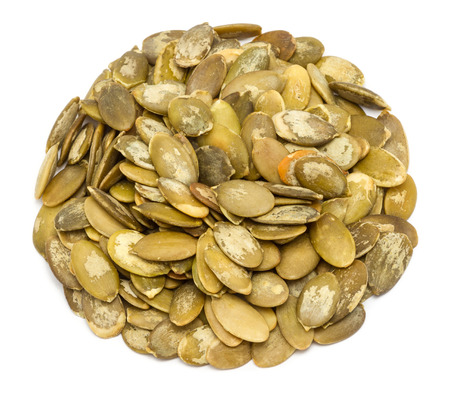 Handful of pumpkin seeds without shell, close up, isolated on white background