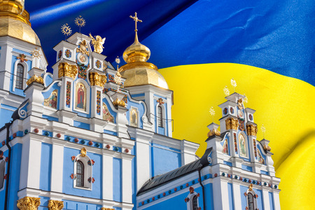View of the St. Michaels Golden-Domed Monastery in Kiev, the Ukrainian Orthodox Church - Kiev Patriarchate, in the background flag of Ukraine, collage