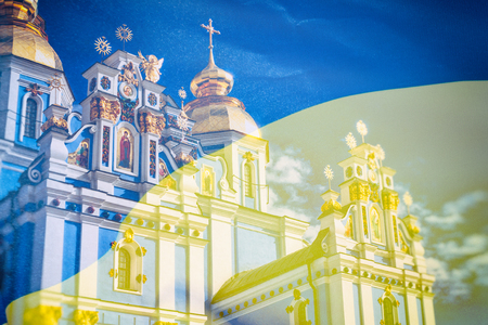 View of the St. Michaels Golden-Domed Monastery in Kiev, the Ukrainian Orthodox Church - Kiev Patriarchate, in the background flag of Ukraine, double exposure photo
