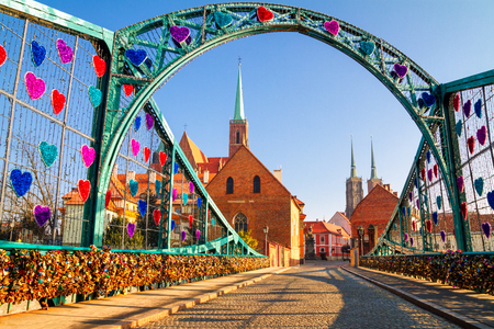 View of the pedestrian Tumski Bridge (is also called Lovers Bridge, Cathedral Bridge or Green Bridge), adorned with many love locks and hearts, Wroclaw, the Poland