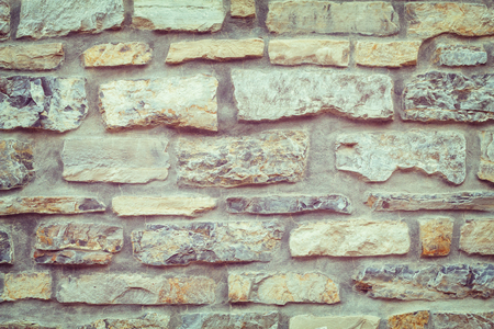 Old weathered brick wall of medieval fortress, horizontal grunge background
