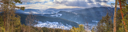 Winter landscape, panorama, banner - top view of the snowy valley in the Carpathians Mountains, in Ukraine