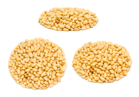 Set of handfuls of seeds from different angles - peeled pine nut kernels, close up, isolated on white background
