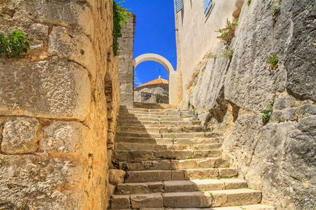 Summer mediterranean landscape - view of the stairs in the Klis Fortress, near Split on the Adriatic coast of Croatia