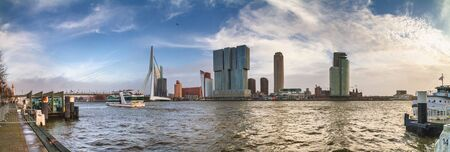 Cityscape, panorama, banner - view of the city embankment and the Erasmus Bridge, as well district Feijenoord city of Rotterdam, The Netherlands Stok Fotoğraf