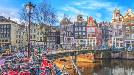 Cityscape on a sunny winter day - view of the bike parking in the historic center of Amsterdam, The Netherlands Stok Fotoğraf