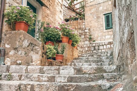 Mediterranean summer cityscape - view of a medieval street with stairs in the Old Town of Dubrovnik on the Adriatic Sea coast of Croatia Stok Fotoğraf