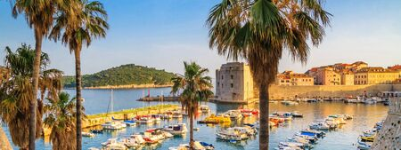 Coastal summer landscape - view of the City Harbour of the Old Town of Dubrovnik and Lokrum isle on the Adriatic coast of Croatia