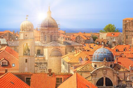 Summer mediterranean cityscape - view of the roofs of the Old Town of Dubrovnik with the Church of St. Blaise and the Assumption Cathedral, on the Adriatic coast of Croatia