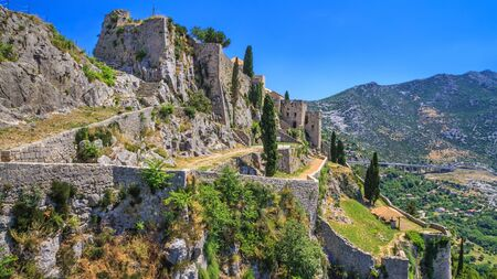 Summer mediterranean landscape - view of the Klis Fortress, which is located near Split on the Adriatic coast of Croatia
