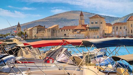 Coastal summer landscape - view of the marina for boats and of the Old Town of Trogir, the Adriatic coast of Croatia