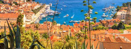 Coastal summer landscape - view of the City Harbour of the town of Hvar and Paklinski Islands, the island of Hvar, the Adriatic coast of Croatia Stok Fotoğraf