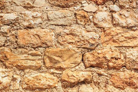 Old weathered brick medieval wall, horizontal grunge background, in Hvar old town quarter, in Croatia Stok Fotoğraf