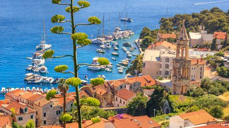 Coastal summer landscape - view of the City Harbour and marina of the town of Hvar, on the island of Hvar, the Adriatic coast of Croatia