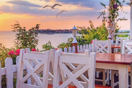 Seaside landscape - the cafe on the embankment view of the Old Town of Nesebar, in Burgas Province on the Black Sea coast of Bulgaria