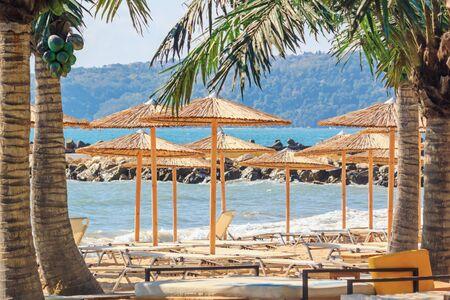 Coastal landscape - view of the beach umbrellas and loungers, city of Varna, on the Black Sea coast of Bulgaria Stok Fotoğraf