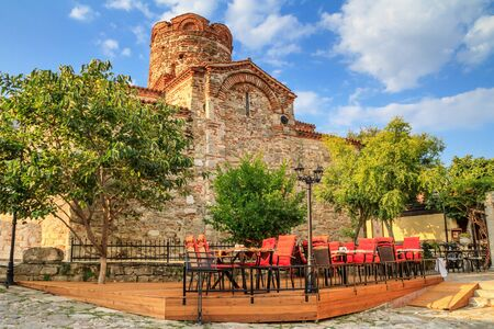 Cityscape with historic buildings - view of the Church of Saint John the Baptist in the Old Town of Nesebar, in Burgas Province on the Black Sea coast of Bulgaria