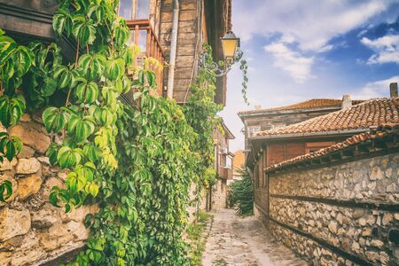 City landscape - view of the old streets and homes in balkan style, the Old Town of Nesebar, in Burgas Province on the Black Sea coast of Bulgaria