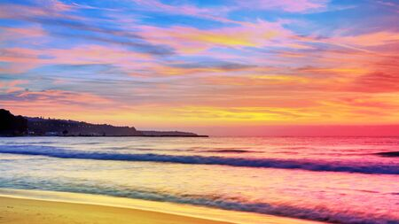 Colorful sunrise with long exposure effect for background, seaside landscape - the beach with views of the sunrise over the sea, near the city of Varna, on the Black Sea coast of Bulgaria