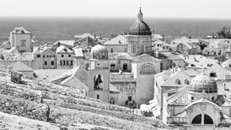 Mediterranean cityscape in black-and-white color - view of the old roof on the background of the Old Town of Dubrovnik on the Adriatic coast of Croatia, closeup Stok Fotoğraf