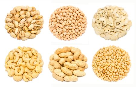 Set of different types of nuts - pistachio nuts in the shell, chickpea seeds without shell, pumpkin seeds in the shell, raw cashew seeds without shell, peanut (Arachis hypogaea) in the shell, peeled pine nut kernels, isolated on white background Stok Fotoğraf