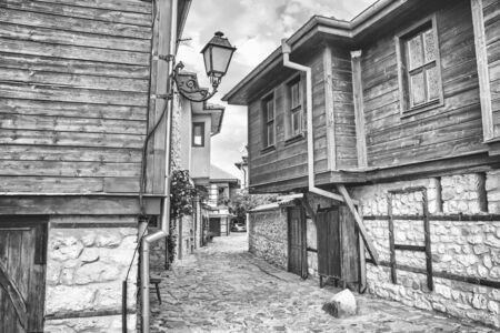 City landscape, in black-and-white color - view of the old streets and homes in balkan style, the Old Town of Nesebar, in Burgas Province on the Black Sea coast of Bulgaria Stok Fotoğraf