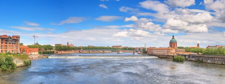 Summer city landscape, panorama, banner - view of the Garonne river in the city of Toulouse, in the historical province Languedoc, the region of Occitanie of southern France